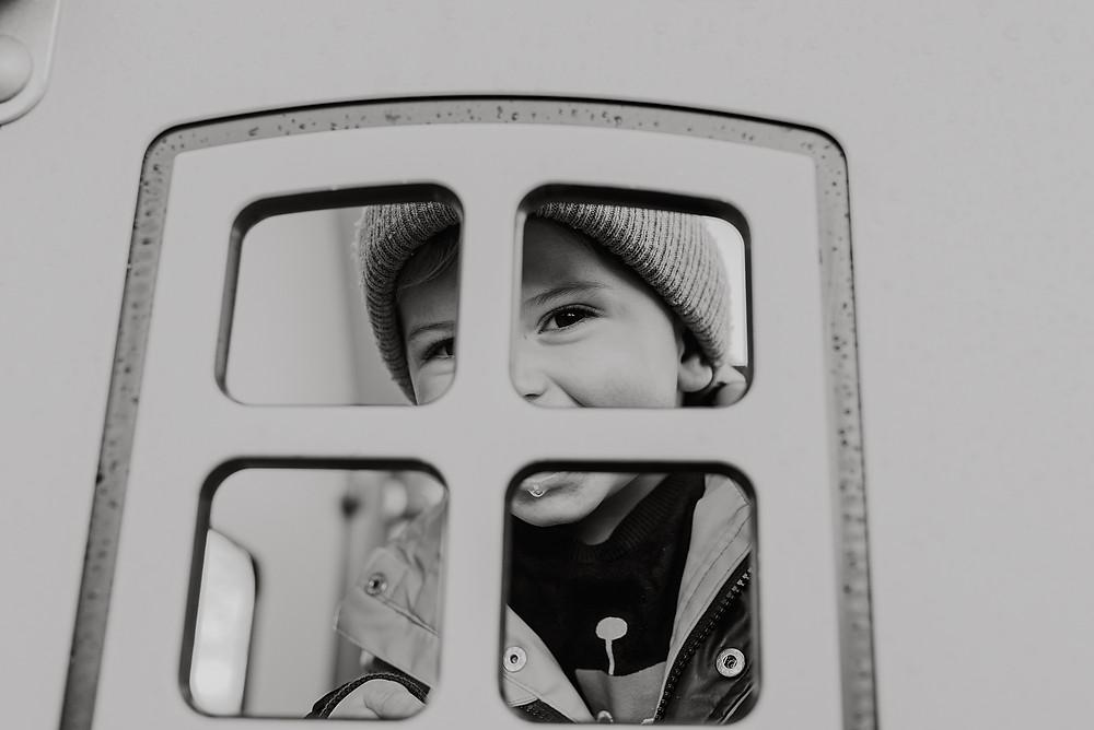 peeking through climbing frame candid