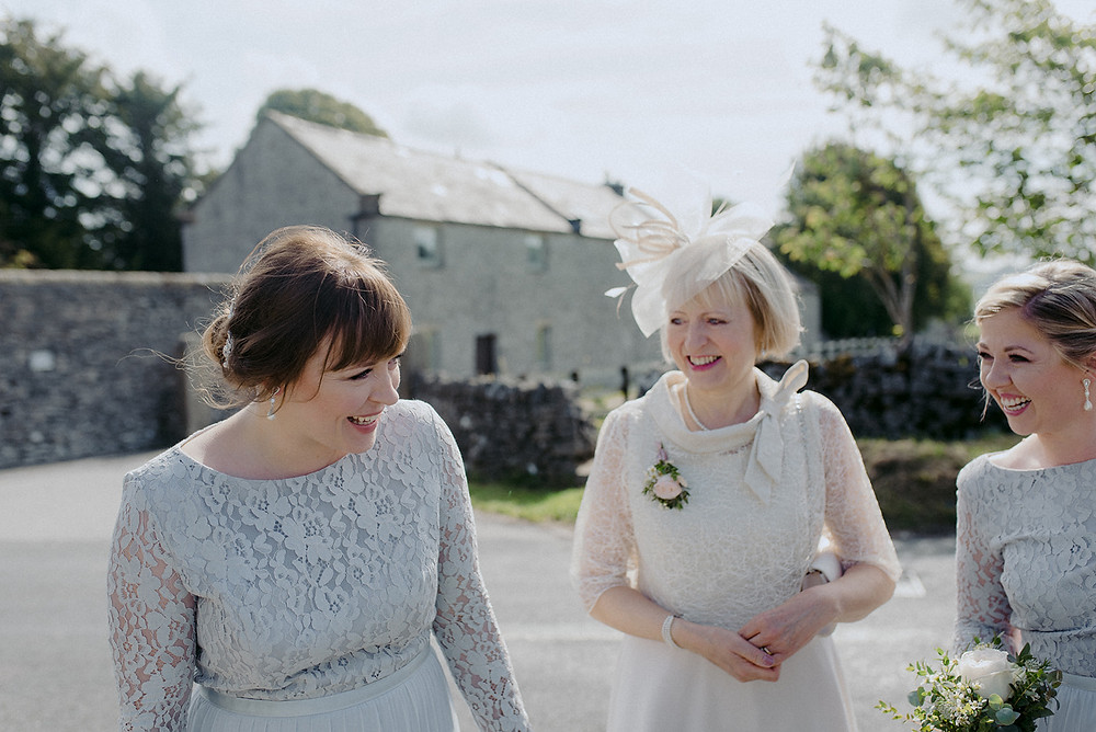 documentary photo of bridesmaids and mother of the bride