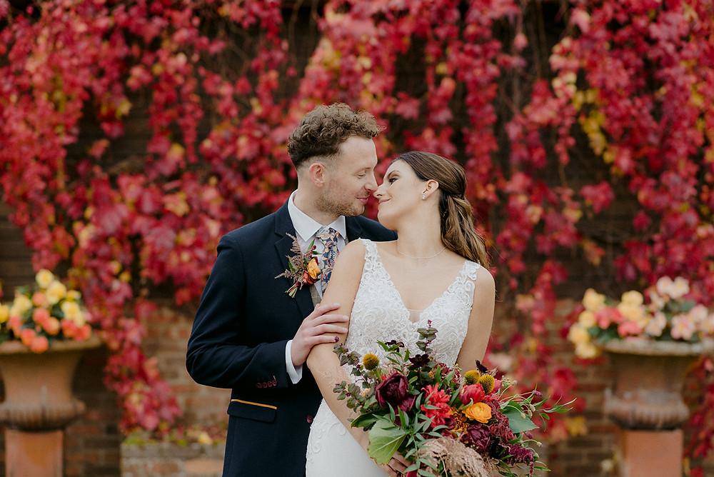 outdoor wedding with red ivy autumn wedding