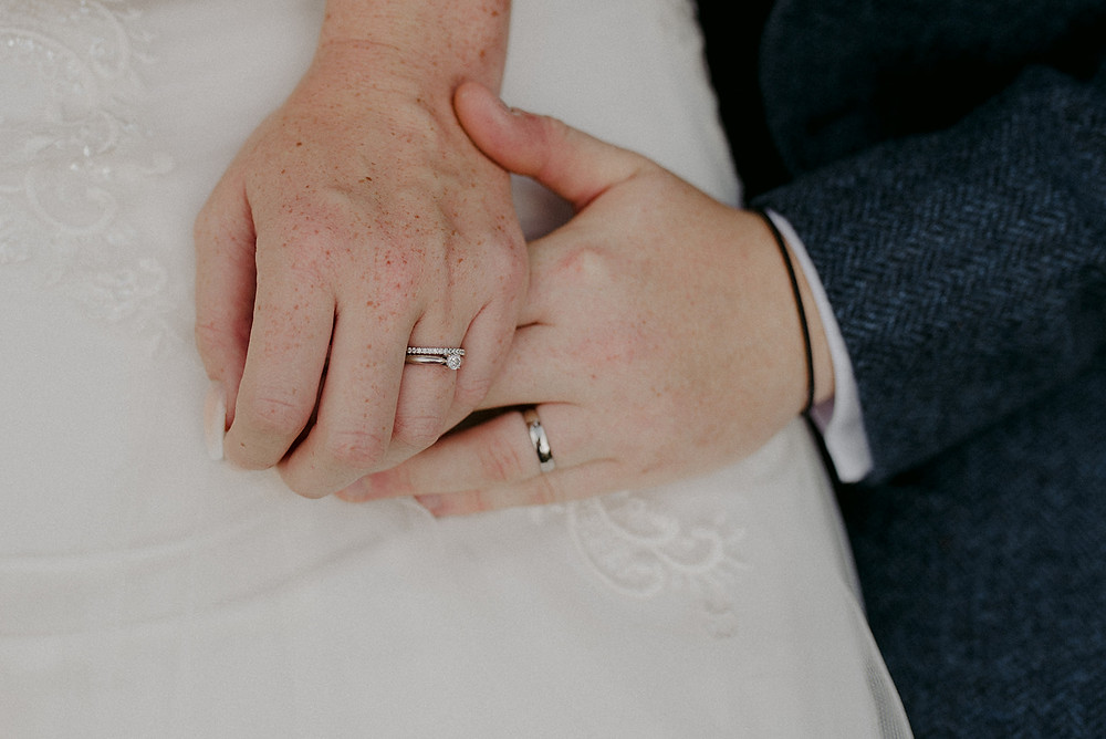 close up of wedding rings on hands