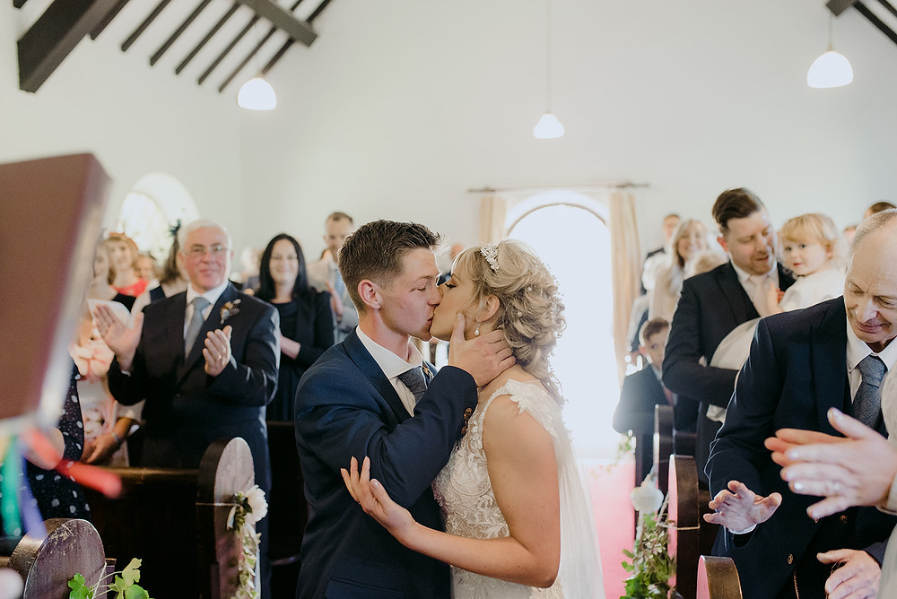 bride and groom first kiss wedding photography
