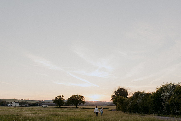 photo of couple in field