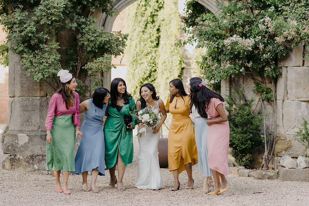bride and bridesmaids candid photo