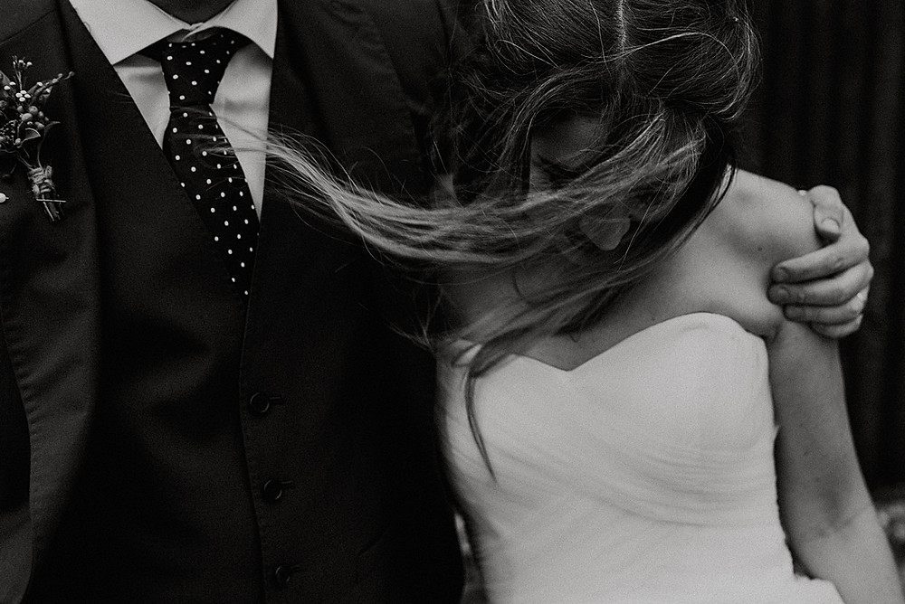 black and white editorial style shot of bride and groom