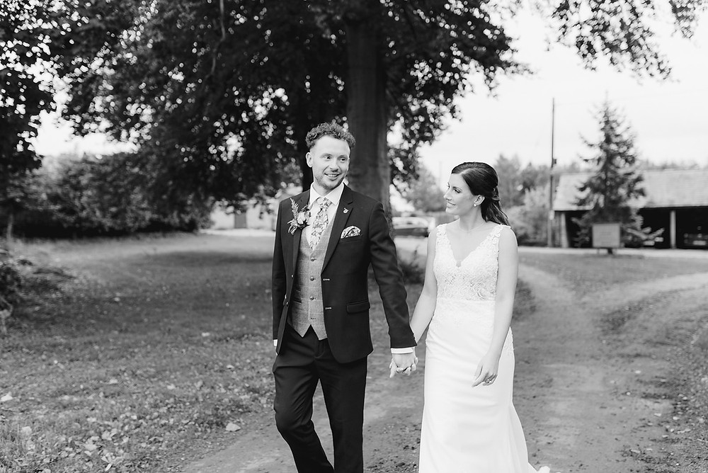 natural photo of bride and groom walking