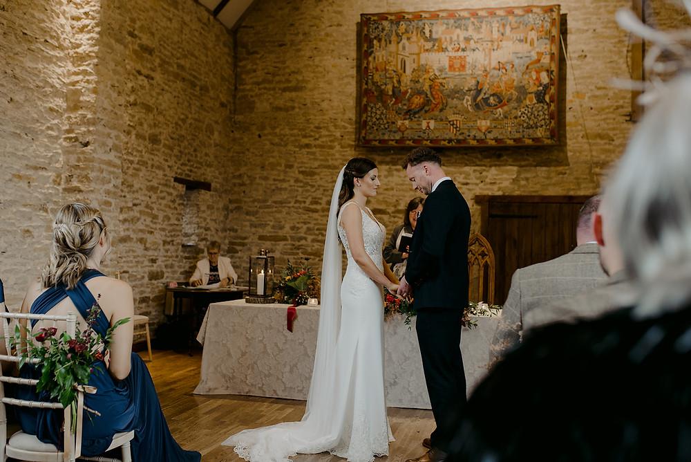 bride and groom wedding ceremony barn