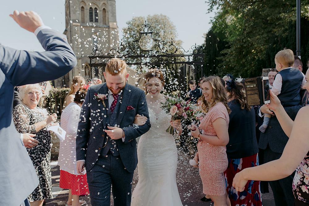 confetti wedding couple exit
