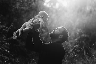 father and newborn son outdoor photography