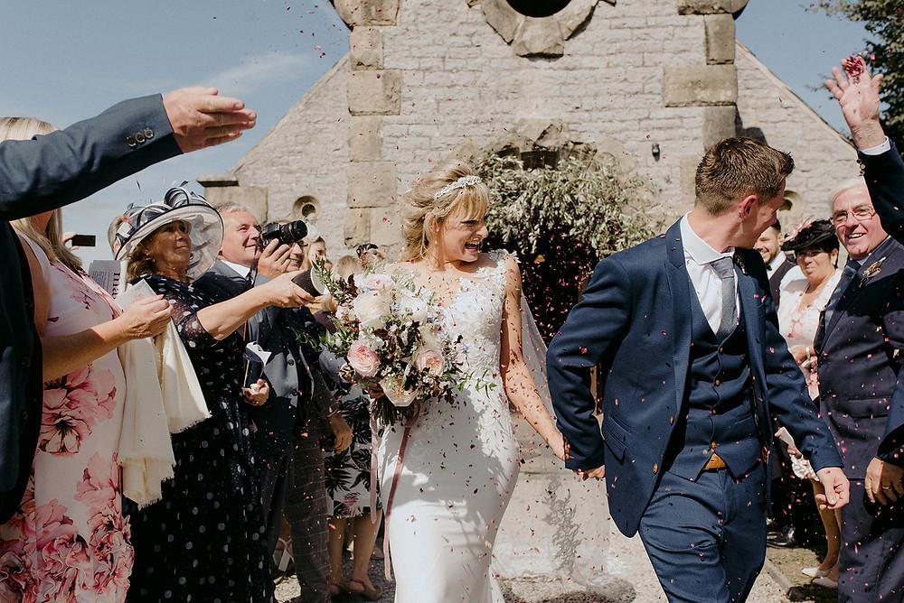 confetti exit bride and groom chapel