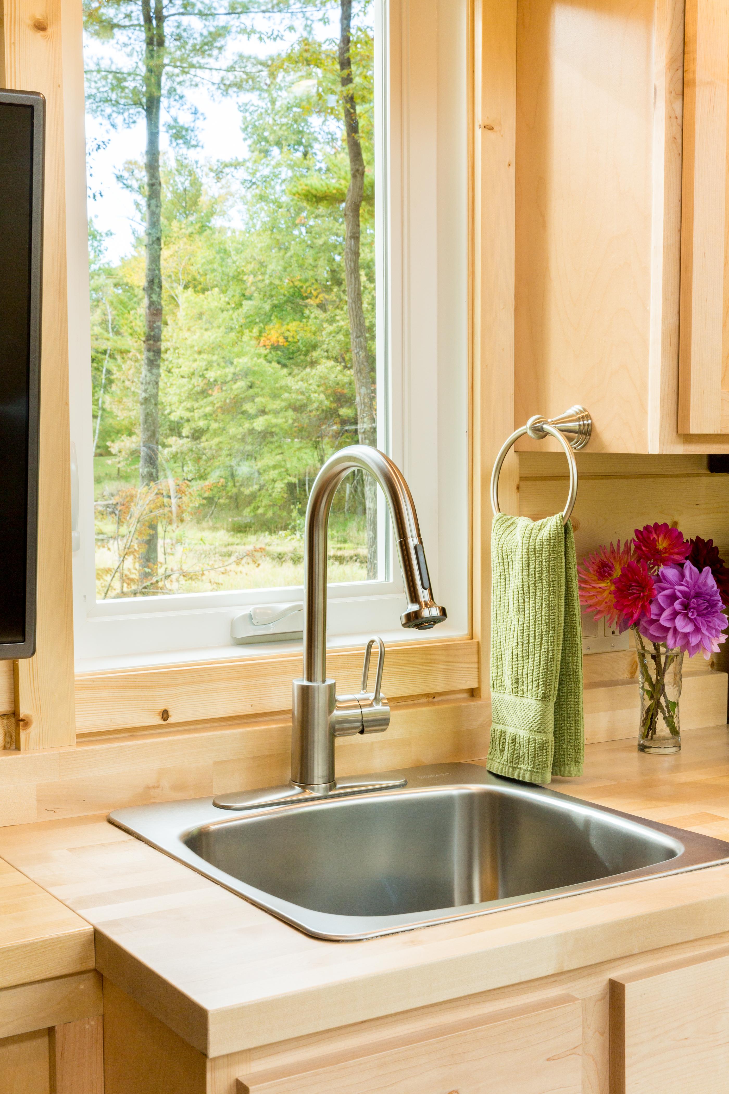 Designer faucet/seep sink