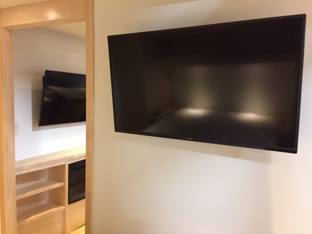 UHD Smart TV in Living Area and Bedroom