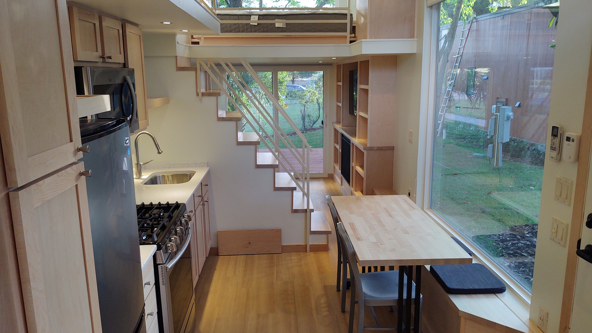 Central Staircase + Large Windows