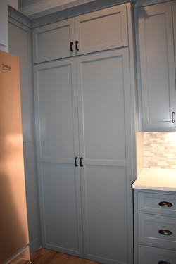 Doors entering hidden pantry