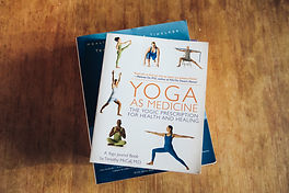 pile of books about yoga