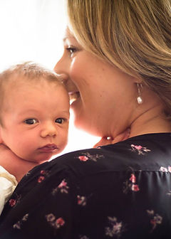 photograph of charlotte harley from her website charlotteharleycancldes.co.uk, with her son looking over shoulder