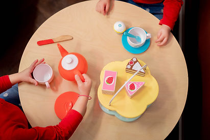 Children's tea party with wooden cakes and tea cups at Little City