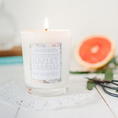 Image of a rose geranium candle from Charlotte Harley, lit candle
