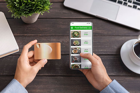 Man-using-mobile-ordering-and-food-deliv