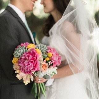 Carly's and Wadsworth are married! Bouquet of peonies, succulents, tulips, and more