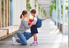 first day at school. mother leads a litt