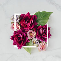 Creative layout made with flowers and wh