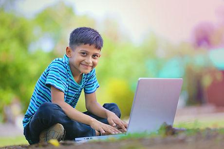 Boy at computer.jpeg
