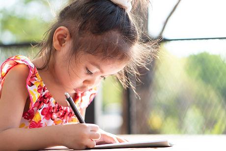 Girl writing.jpeg