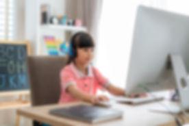 Girl at computer.jpeg