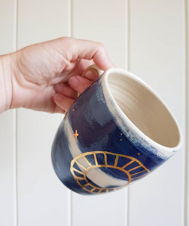 coffee mugs in indigo and gold