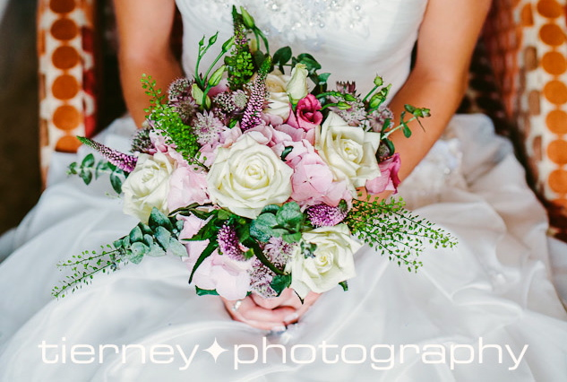 Touch of pink hydrangea in between roses, astrantia, lisyanthus, veronica and thelspi bell