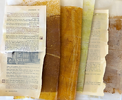 Mono printed collage papers in cream, yellow-browns and yellow-green.