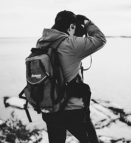 grayscale-photography-of-man-taking-phot