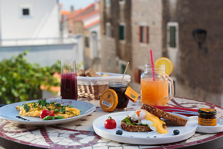 breakfast or brunch table with omelette, organic jams, spreads and natural juices in Vodice