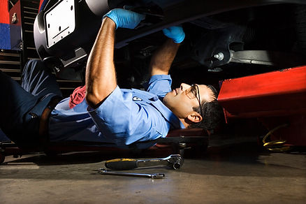mechanic checking a car for regural maintenance