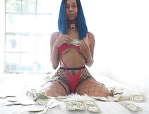 female in fishnets and a slingshot bodysuit with money around her
