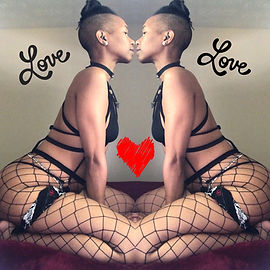woman showing self love in fishnets and a harness facing herself with the word love on each side