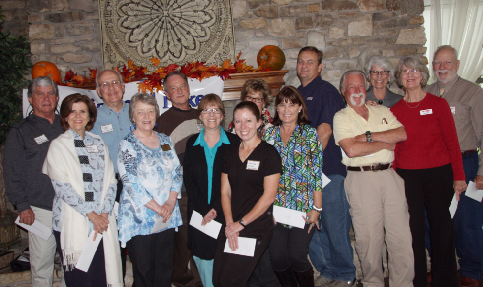 President Quigley accepting check from Highland Lakes Service League
