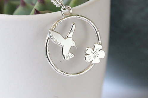 Sterling silver humming bird and flower necklace