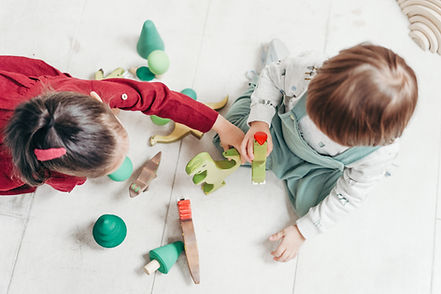 Canva - Children Playing With Animal Toy