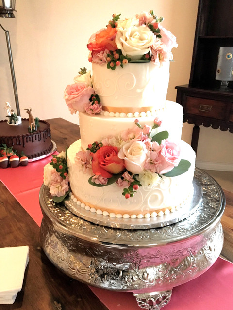 Coral Roses make this Candy Haven Cake a Beautiful Focal Point..