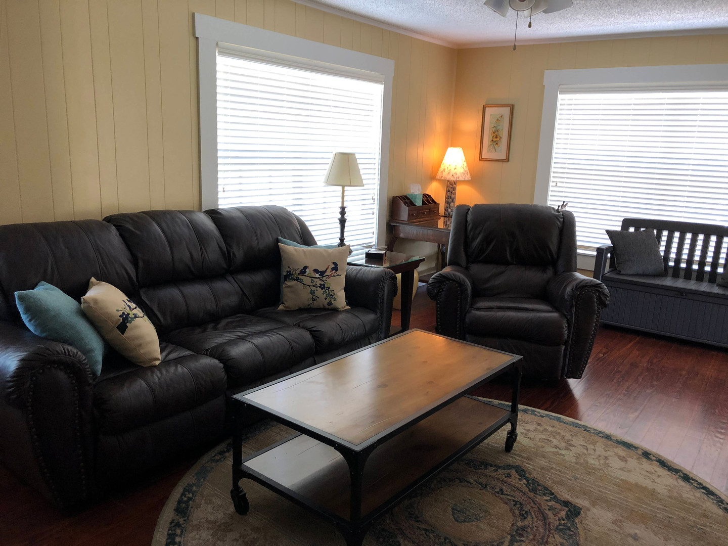 Living room with leather sofa and recliner.