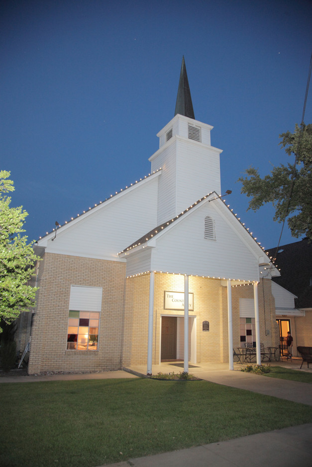 Twilight falls on the chapel.