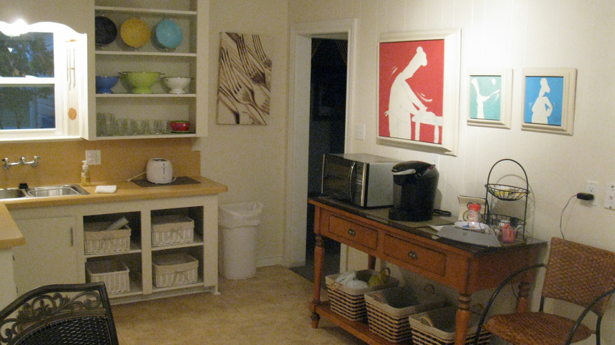The kitchen with microwave, toaster, and Keurig.