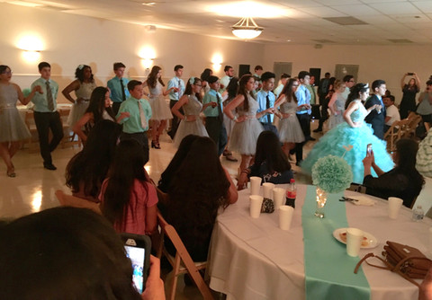 A quinceanera with a full court of attendants.