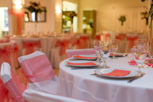 Chair covers with the a coral bow add happiness.