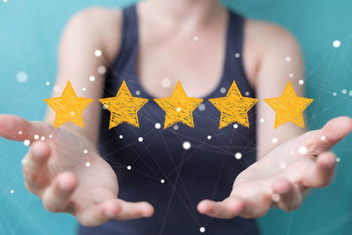 Person holding 5 stars.