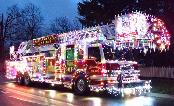 A firetruck apparatus decorated for the holidays