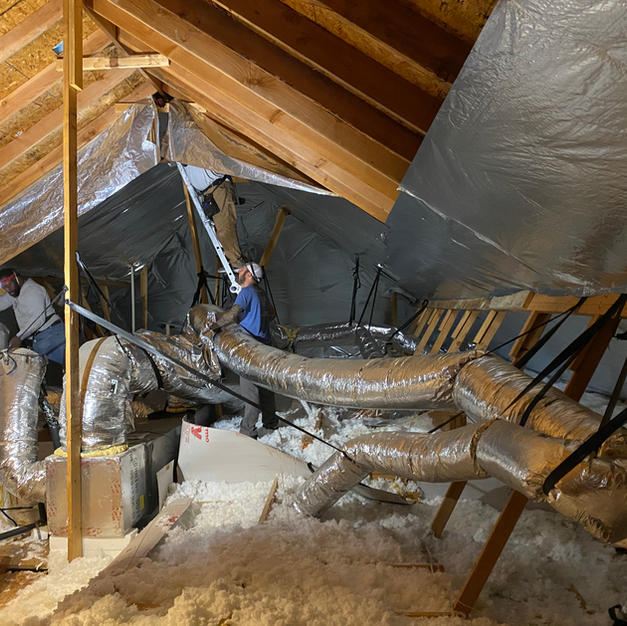 The HeatBusters hard at work. Our crews are throughly trained to work in the extreme attic conditions.