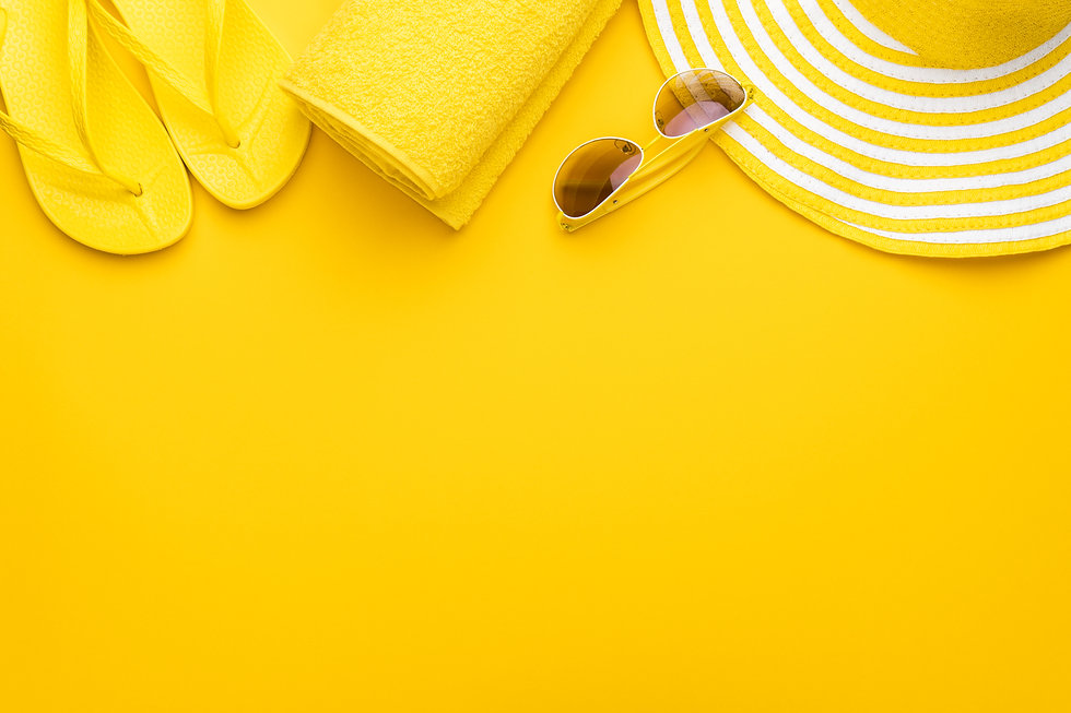 beach accessories on the yellow backgrou