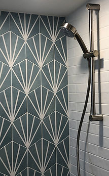 Shower head with tiles behind